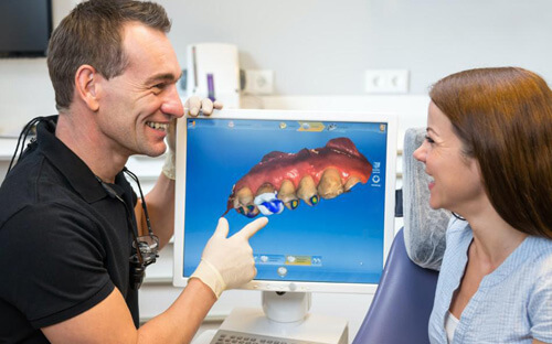 Patient and dentist discussing smiling with each other
