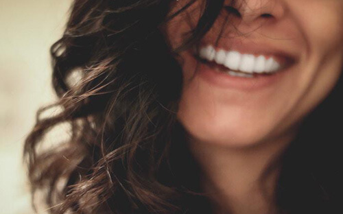 Beautiful smiling woman showing her white teeth