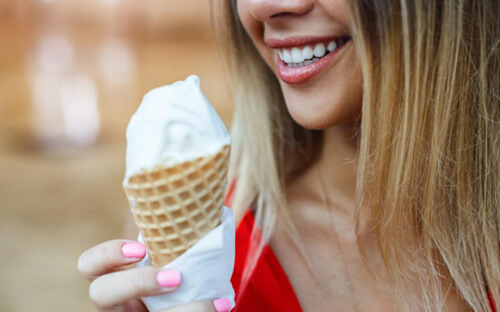 Smiling woman holding an ice cream cone